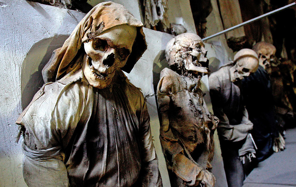 Fully clothed human remains, representing some of the world's best-preserved bodies, are displayed at the Capuchin Catacombs in Palermo, southern Italy, January 31, 2011. The catacombs, frequented by tourists, contain thousands of remains of clerics, nobility, and families of local citizens dating from about the mid-16th century, well preserved due to an ancient and highly effective embalming process. Originally intended for friars of the Capuchin monastery, the catacombs evolved, with the aid of donations, into a place where family members would visit, spend time with and even change the clothes of the deceased. The last burial was Rosalia Lombardo, two-years old, in the 1920s. REUTERS/Tony Gentile (ITALY - Tags: SOCIETY IMAGES OF THE DAY)