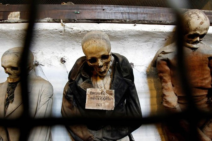 Fully clothed human remains, representing some of the world's best-preserved bodies, are displayed at the Capuchin Catacombs in Palermo, southern Italy, January 31, 2011. The catacombs, frequented by tourists, contain thousands of remains of clerics, nobility, and families of local citizens dating from about the mid-16th century, well preserved due to an ancient and highly effective embalming process. Originally intended for friars of the Capuchin monastery, the catacombs evolved, with the aid of donations, into a place where family members would visit, spend time with and even change the clothes of the deceased. The last burial was Rosalia Lombardo, two-years old, in the 1920s. REUTERS/Tony Gentile (ITALY - Tags: SOCIETY)